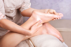 Feet massage spa salon. Closeup of feet, Caucasian women having a massage spa salon Stock Images