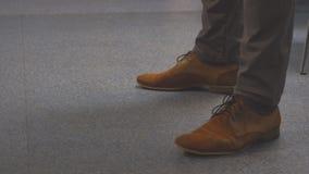Feet men in brown shoes. Feet nervous men in brown shoes stock footage