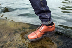 Feet of Men  in selvedge jeans and retro shoes Royalty Free Stock Images