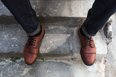 Feet of Men  in selvedge jeans and retro shoes Stock Photos