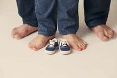 Feet men and women in jeans Royalty Free Stock Photo