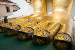 Detail of feet of the Great Buddha in Bangkok Royalty Free Stock Image