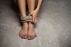 Feet of a missing kidnapped, abused, hostage, victim woman tied Stock Photos