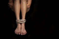 Feet of a missing kidnapped, abused, hostage, victim woman tied Royalty Free Stock Photo