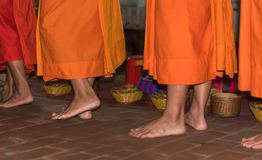 ceb390f672bd The feet of monks close-up. Feeding the monks. The ritual is called