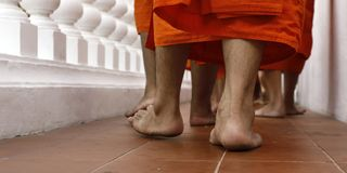 Feet of monks walking Royalty Free Stock Images