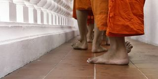 Feet of monks walking Royalty Free Stock Photography