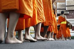 Feet of monks walking. In buddhist temple Royalty Free Stock Images