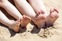 Feet of mother and her child Royalty Free Stock Images