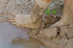 Feet muddy ground. Royalty Free Stock Image