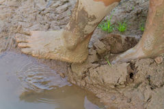 Feet muddy ground. Royalty Free Stock Photo
