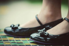 Feet in a new stylish shoes. Feet in a new stylish black shoes Stock Photo
