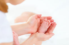 Feet newborn baby in arms him mother Royalty Free Stock Photo