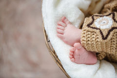 Feet of a newborn baby sleeping on white blanket Royalty Free Stock Images