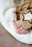 Feet of a newborn baby sleeping on white blanket Stock Images