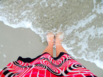 Feet in the ocean wave Royalty Free Stock Images