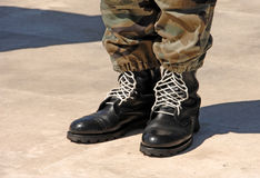 Feet Of Camouflaged Soldier Stock Photos