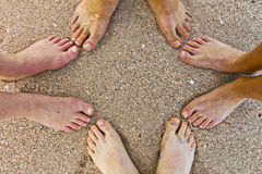 Feet Of Family At The Beach Stock Photo