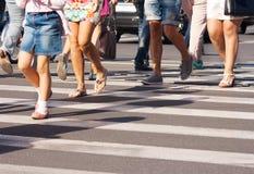 Feet Of The Pedestrians Crossing On City Street Stock Photos