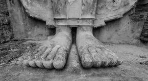 Feet of the old Buddha statue Stock Image