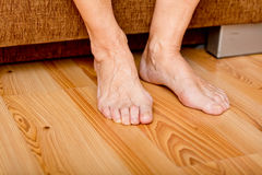 Feet of old woman on the floor Stock Image