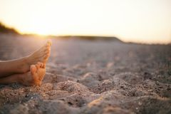 Feet of old woman sitting on beach Stock Photography