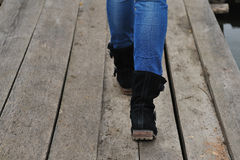 Feet on the old wooden bridge. Royalty Free Stock Images