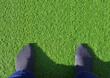 Feet On Artificial Grass Stock Photo