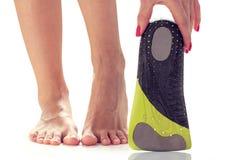 Feet and orthopedic insole stock image