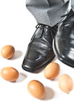 Feet over eggs Royalty Free Stock Photos