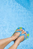 Feet Over the Swimming Pool Stock Photography