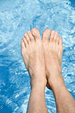 Feet Over the Swimming Pool. Man's feet over the swimming pool Stock Photos