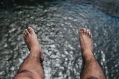 Feet over water Royalty Free Stock Image