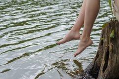 Feet over the water stock photos