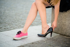 Feet pain - changing shoes Stock Photos