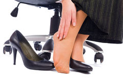 Feet Pain. Wearing high heels has its painful disadvantages - hurting feet, ankle Stock Photos