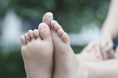 Feet painted on the head of the big toe Royalty Free Stock Photo