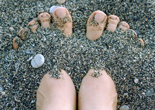Feet in the pebbles Royalty Free Stock Image