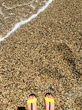 Feet on pebbles stock images