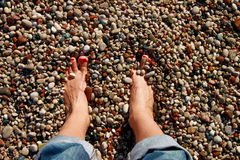 Feet in the pebbles Stock Photo