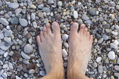 Feet on pebbles or stones Stock Image