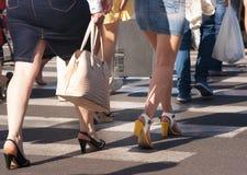 Feet of the pedestrians on city street. Feet of the pedestrians crossing on city street Royalty Free Stock Image