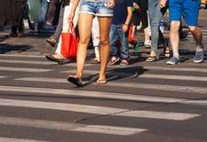 Feet of the pedestrians on city street. Feet of pedestrians walking on the crosswalk on summer day Royalty Free Stock Photos