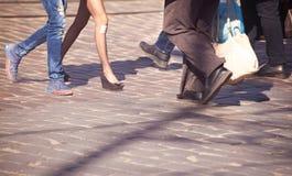 Feet of pedestrians in a crosswalk Stock Photos