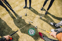 The feet of people playing golf. Sticks, lawn and balls royalty free stock photos