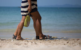 Feet of people walk the beach Stock Photos