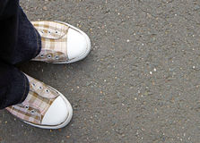 Person in casual check shoes Stock Photo