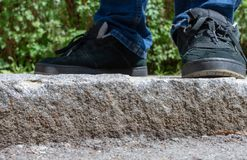 Feet of a person standing on exterior stone steps stock photography