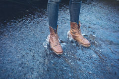 Feet of person standing in shallow, flowing water Royalty Free Stock Photography