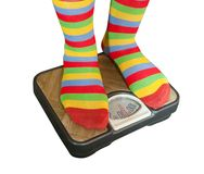 Feet placed on scales Stock Photography
